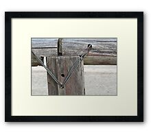 wire in the post Framed Print