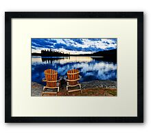 Wooden chairs at sunset on lake shore Framed Print