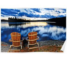Wooden chairs at sunset on lake shore Poster