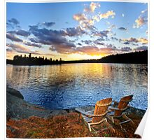 Wooden chairs at sunset on beach Poster