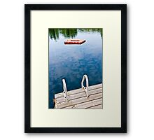 Dock on calm lake in cottage country Framed Print
