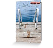 Footprints on dock at summer lake Greeting Card
