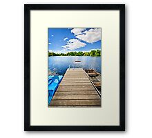 Dock on lake in summer cottage country Framed Print