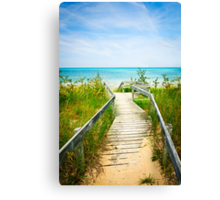 Wooden walkway over dunes at beach Canvas Print