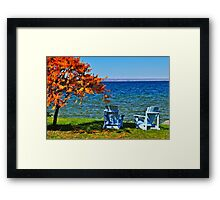 Wooden chairs on autumn lake Framed Print