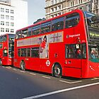 London Red Bus in the strand London by Keith Larby