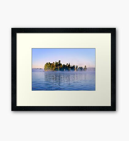 Island in lake with morning fog Framed Print