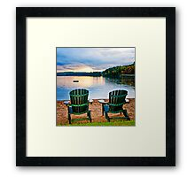 Wooden chairs at sunset on beach Framed Print