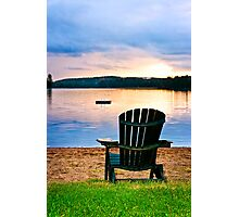 Wooden chair at sunset on beach Photographic Print