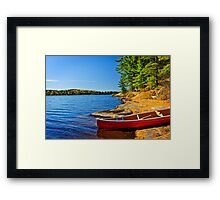Canoe on shore Framed Print