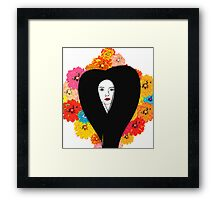 Contrasting Flowers Against An Extensive Face Framed Print