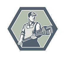 Plumber Holding Plumbing Wrench Retro by patrimonio