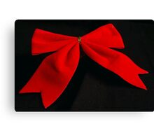 Red bow Canvas Print