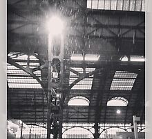 snowing in milan central station by claudioasile