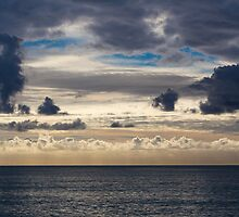 Wonderful cloudy evening sky over the sea by Daniele Zighetti