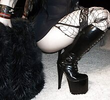 Squatting with 7 inch spike boots by Raven Sparks