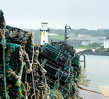 Lobster pots in St Ives harbour by photoeverywhere