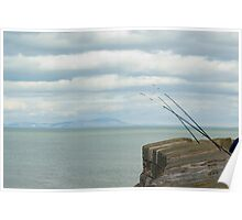 Fishing rods on a sea wall Poster