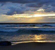 beach sunset with golden sky by lfoliveira