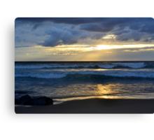 beach sunset with golden sky Canvas Print