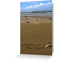 written in the sand on a  beach with feather quill Greeting Card