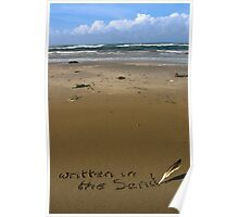 written in the sand on a  beach with feather quill Poster