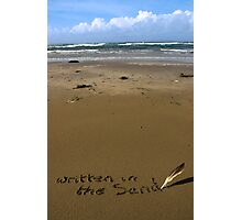 written in the sand on a  beach with feather quill Photographic Print