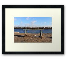 An empty Bench by the river Framed Print