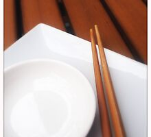 Chopsticks on a White Plate by Roger Passman