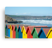 Beach huts at Whitby sands, West Cliff Canvas Print