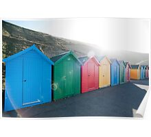 Brightly coloured beach huts Poster