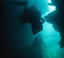 Scuba divers cave diving by photoeverywhere