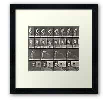 Woman throwing a bucket of water Framed Print