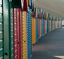 Colourful beach huts, Whitby West Cliff by photoeverywhere
