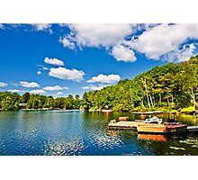 Cottages on lake with docks Photographic Print