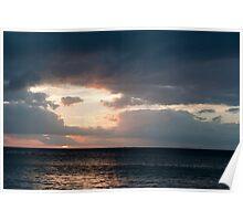 Setting sun over the ocean Poster