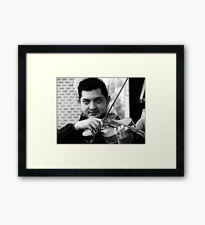The Violininst Framed Print
