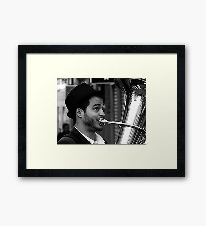 The Muscian and the reflection Framed Print