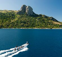 Boat with tourists approaching Waya island by photoeverywhere