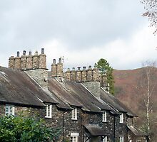 Row of quaint stone cottages at Skelwith Bridge by photoeverywhere