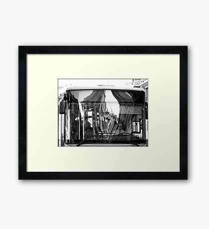 The Bus Driver and the Reflection Framed Print