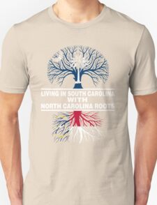 LIVING IN SOUTH CAROLINA WITH NORTH CAROLINA ROOTS Unisex T-Shirt
