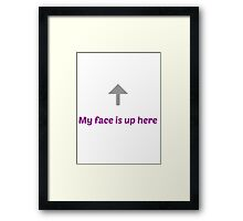 My face is up here Framed Print