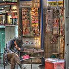 The Paper Seller, Collins Street, Melbourne by Adrian Paul