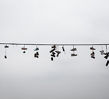 Shoes on a wire by Pierre Bourgault