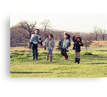 Group of kids jumping Canvas Print