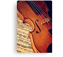 Old rare violin on note sheet Canvas Print