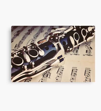 Clarinet on a sheet music Canvas Print