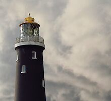 Storm clouds over The Old Lighthouse, Dungeness  by Mortimer123