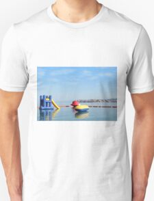 beach toys and equipment floating on sea Unisex T-Shirt
